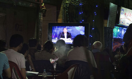 Egyptians watch comedian Bassem Youssef