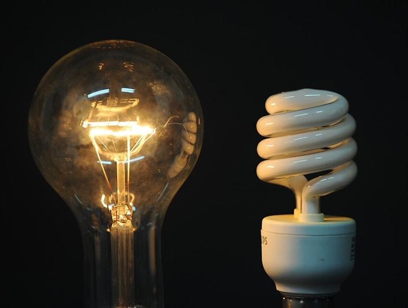 a_traditional_incandescent_light_bulb_and_its_low__485f489caa22
